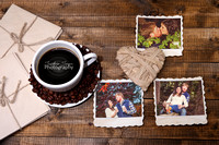 Coffee cup and old blank photos, on wooden background